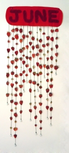 """Harvesting the Strawberry in the Midwest"", 35 x 14 inches, watercolor on paper, string, fabric, 2012.  Image courtesy of Kim Guare."
